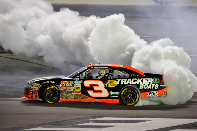 Austin Dillon celebrates his win with a burnout after the NASCAR Nationwide Series auto race at Kentucky Speedway, Friday, June 29, 2012, in Sparta, Ky.
