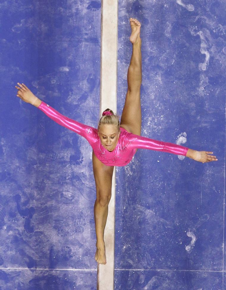 Nastia Liukin performs on the balance beam.