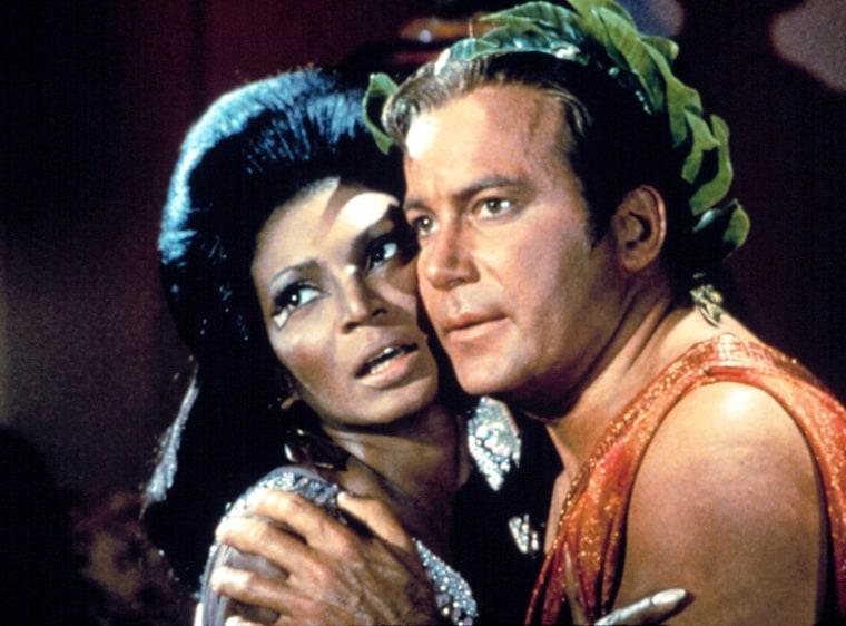 STAR TREK, William Shatner, Nichelle Nichols, Season 3, Episode 67, 'Plato's Stepchildren.' The first interracial kiss on TV, November 22, 1968.(c)Paramount TV. Courtesy: Everett Collection.