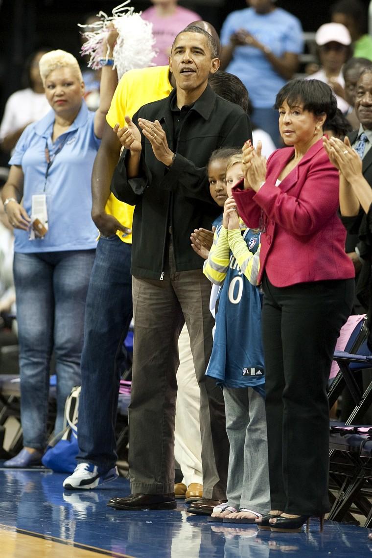 President Obama, at a Washington Mystics game with Sasha in August.