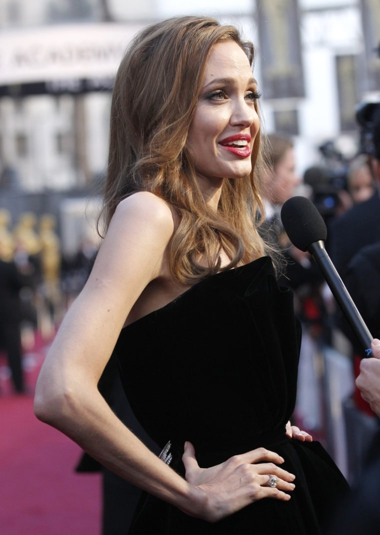 Actress Angelina Jolie is interviewed at the 84th Academy Awards in Hollywood, California, February 26, 2012.  REUTERS/Mario Anzuoni    (UNITED STATES) (OSCARS-ARRIVALS)