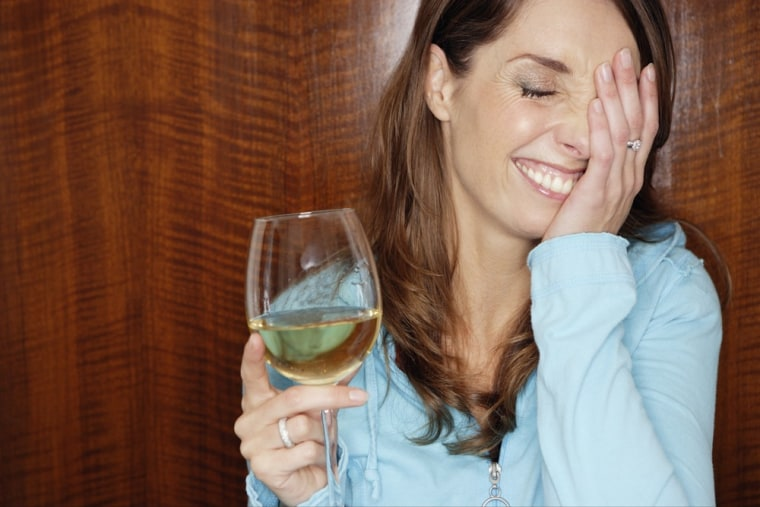 Shy woman drinking white wine