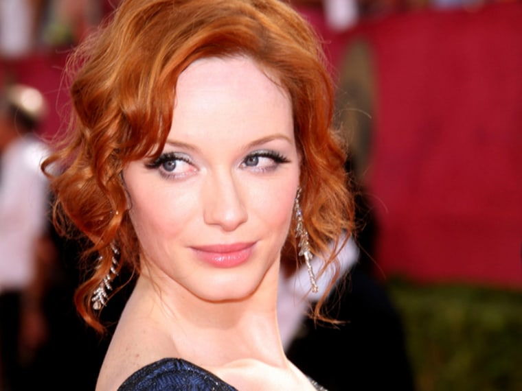 LOS ANGELES, CA - SEPTEMBER 20:  Actress Christina Hendricks arrives at the 61st Primetime Emmy Awards held at the Nokia Theatre on September 20, 2009 in Los Angeles, California.  (Photo by Jason Merritt/Getty Images)