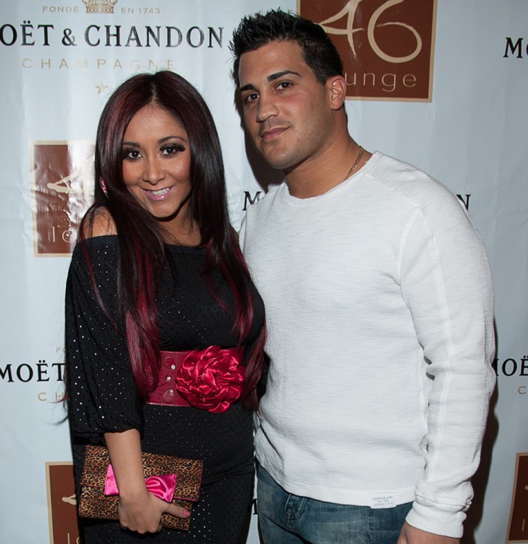 """TOTOWA, NJ - FEBRUARY 09:  Nicole \""""Snooki\"""" Polizzi and boyfriend Jionni LaValle hosts an evening at 46 Lounge on February 8, 2012 in Totowa, New Jersey.  (Photo by Dave Kotinsky/Getty Images)"""