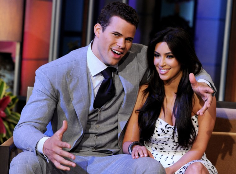 BURBANK, CA - OCTOBER 04:  NBA player Kris Humphries (L) and his wife reality TV personality Kim Kardashian appear on the Tonight Show With Jay Leno at NBC Studios on October 4, 2011 in Burbank, California.  (Photo by Kevin Winter/NBCUniversal/Getty Images)