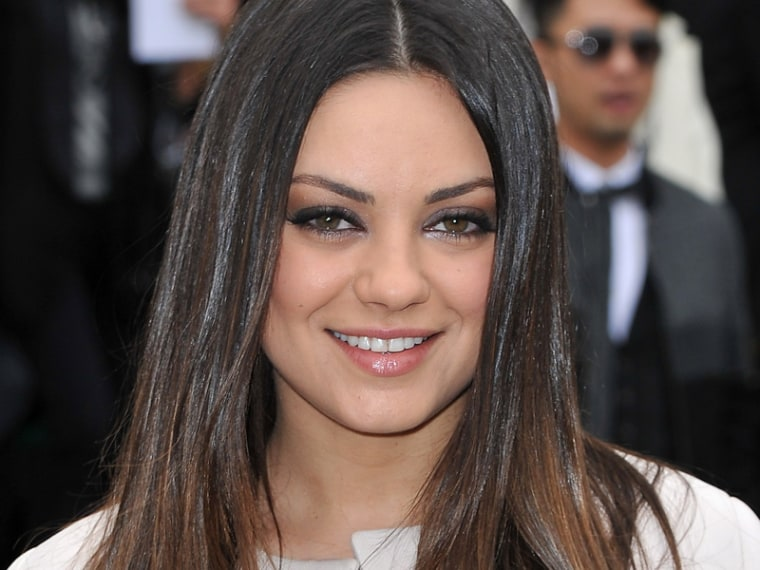PARIS, FRANCE - MARCH 02:  Mila Kunis attends the Christian Dior Ready-To-Wear Fall/Winter 2012 show as part of Paris Fashion Week at Musee Rodin on March 2, 2012 in Paris, France.  (Photo by Pascal Le Segretain/Getty Images)