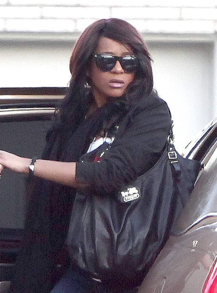 NEWARK, NJ - FEBRUARY 17:  Bobbi Kristina Houston arrives at Whigham Funeral Home for a private viewing for her mother Whitney Houston on February 17, 2012 in Newark, New Jersey. Whitney Houston was found dead in her hotel room at The Beverly Hilton hotel on February 11, 2012.  (Photo by Paul Zimmerman/Getty Images)