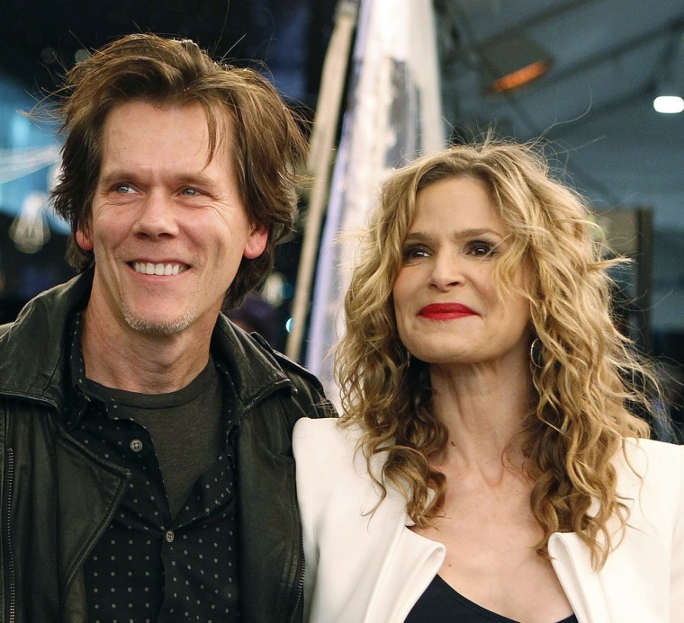 Actor Kevin Bacon (left) and his wife, actress Kyra Sedgwick arrive for the Sirius Radio 20 Million Subscriber celebration concert with Paul McCartney at the Apollo Theater in New York December 13, 2010. REUTERS/Shannon Stapleton (UNITED STATES - Tags: ENTERTAINMENT)