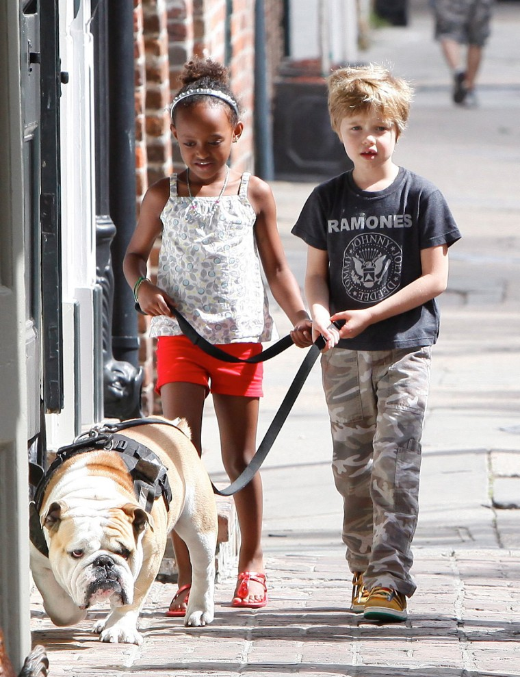 Shiloh and Zahara walking the dog in New Orleans March 7, 2012 X17online.comRS/X17online.com