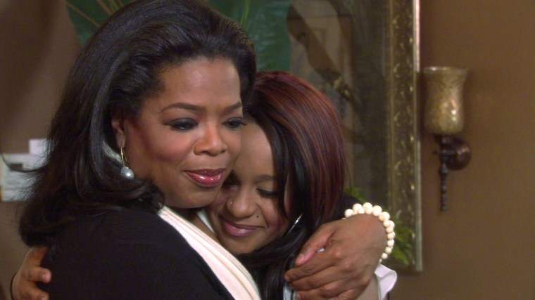 """Oprah Winfrey gives a hug to Bobbi Kristina Brown, daughter of the late singer Whitney Houston, during a March 2, 2012 taping of an interview in Atlanta, Georgia, in this video screen grab released to Reuters March 6, 2012. The  interview will be telecast as a special episode of \""""Oprah's Next Chapter\"""" on OWN: Oprah Winfrey Network on March 11, 2012. Winfrey also interviewed the late singer's sister-in-law and manager Patricia Houston and brother Gary Houston for the program. REUTERS/Copyright 2012 Harpo, Inc./Handout (UNITED STATES - Tags: ENTERTAINMENT TPX IMAGES OF THE DAY) NO SALES. NO ARCHIVES. FOR EDITORIAL USE ONLY. NOT FOR SALE FOR MARKETING OR ADVERTISING CAMPAIGNS. THIS IMAGE HAS BEEN SUPPLIED BY A THIRD PARTY. IT IS DISTRIBUTED, EXACTLY AS RECEIVED BY REUTERS, AS A SERVICE TO CLIENTS. NO COMMERCIAL USE"""