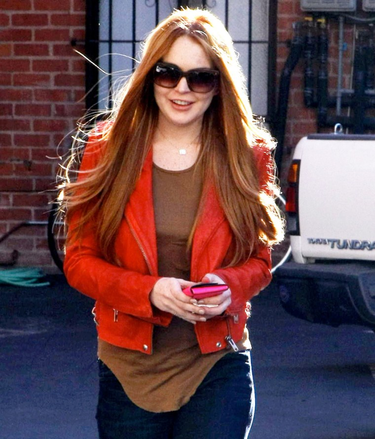 Lindsay Lohan leaves the dentist and shows off her beautiful red locks. March 8, 2012 X17online.com