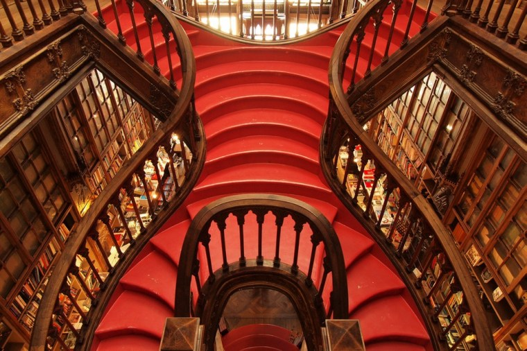 Opened in 1906, Lello Bookshop in Porto, Portugal, is one of the world's most beautiful bookstores, thanks largely to its glossy red staircase with carved wooden banisters that leads up to a glass atrium.