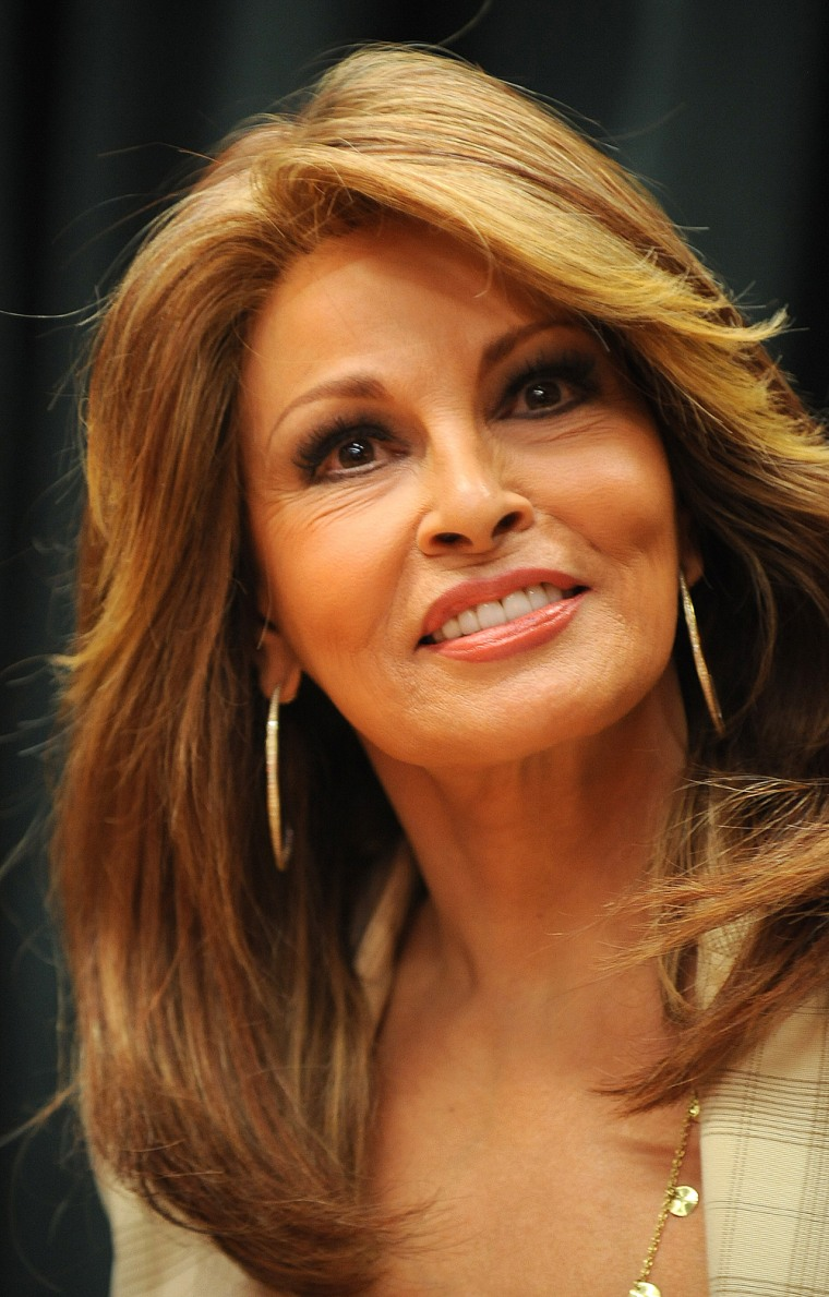 """Actress Raquel Welch signs copies of her book \""""Raquel: Beyond the Cleavage\"""" at Vroman's Bookstore in Pasadena, California on April 22, 2010.  AFP PHOTO / ROBYN BECK (Photo credit should read ROBYN BECK/AFP/Getty Images)"""