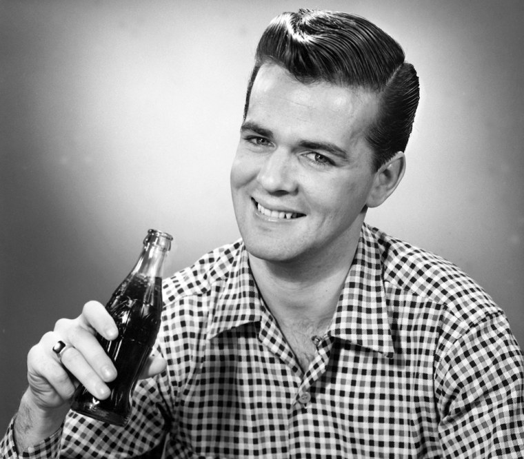 UNITED STATES - CIRCA 1950s:  Man drinking soda.  (Photo by George Marks/Retrofile/Getty Images)