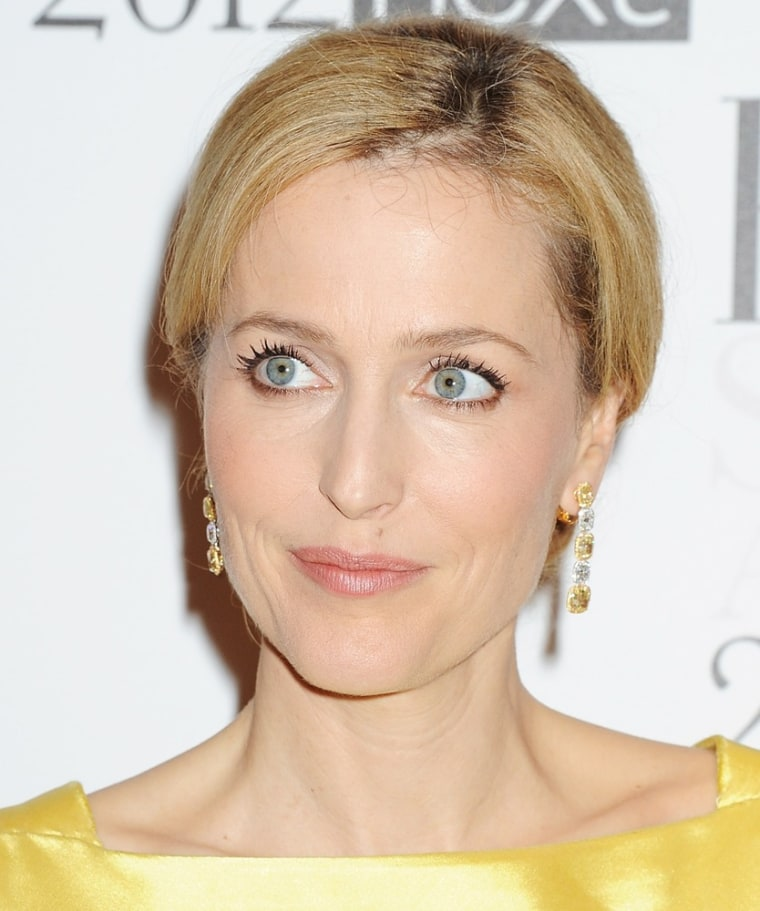 LONDON, ENGLAND - FEBRUARY 13:  (EMBARGOED FOR PUBLICATION IN UK TABLOID NEWSPAPERS UNTIL 48 HOURS AFTER CREATE DATE AND TIME. MANDATORY CREDIT PHOTO BY DAVE M. BENETT/GETTY IMAGES REQUIRED)  Actress Gillian Anderson arrives at the ELLE Style Awards at The Savoy Hotel on February 13, 2012 in London, England.  (Photo by Dave M. Benett/Getty Images)