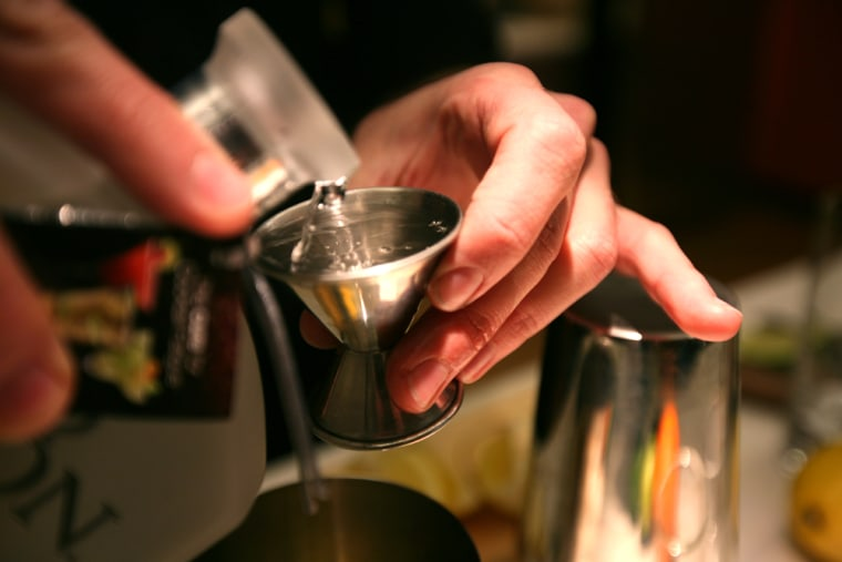 Bartender Nathan Paluck pours pisco, a traditional South American spirit gaining popularity in the United States.