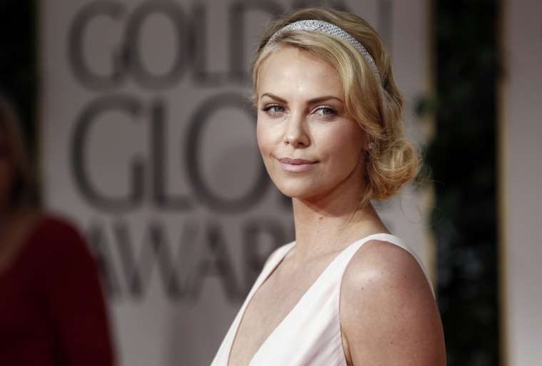 Charlize Theron arrives at the 69th Annual Golden Globe Awards Sunday, Jan. 15, 2012, in Los Angeles. (AP Photo/Matt Sayles)