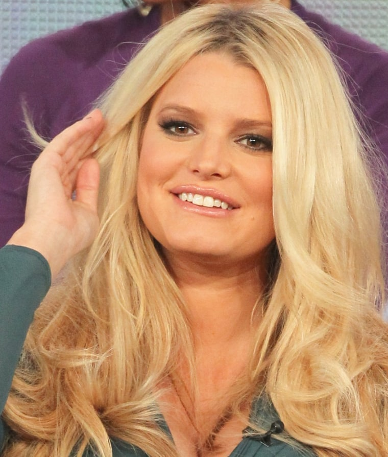 """PASADENA, CA - JANUARY 06:  Celebrity Mentor Jessica Simpson speaks onstage during the \""""Fashion Star\"""" panel during the NBCUniversal portion of the 2012 Winter TCA Tour at The Langham Huntington Hotel and Spa on January 6, 2012 in Pasadena, California.  (Photo by Frederick M. Brown/Getty Images)"""