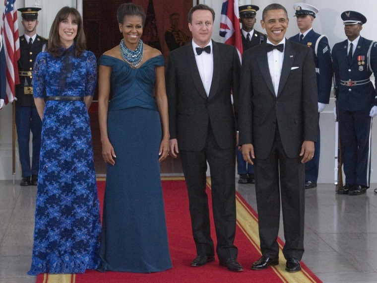 U.S. President Barack Obama (R) and First Lady Michelle Obama (2nd L) receive Britain's Prime Minister David Cameron (2nd R) and his wife Samantha (L) as they arrive for an official dinner in their honor at the White House in Washington March 14, 2012. REUTERS/Jonathan Ernst (UNITED STATES - Tags: POLITICS TPX IMAGES OF THE DAY)