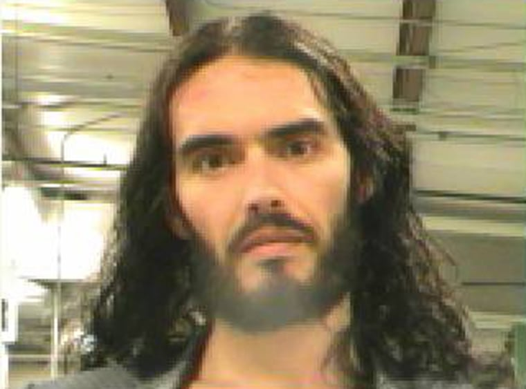 British actor Russell Brand is pictured in this booking photograph handout released by the Orleans Parish Sheriff's Office March 15, 2012. An arrest warrant for Brand has been issued in New Orleans, after a photographer accused the British comedian and actor of grabbing his iPhone and tossing it through a window on Monday, police said on Thursday. REUTERS/Orleans Parish Sheriff's Office/Handout  (UNITED STATES - Tags: ENTERTAINMENT CRIME LAW) FOR EDITORIAL USE ONLY. NOT FOR SALE FOR MARKETING OR ADVERTISING CAMPAIGNS. THIS IMAGE HAS BEEN SUPPLIED BY A THIRD PARTY. IT IS DISTRIBUTED, EXACTLY AS RECEIVED BY REUTERS, AS A SERVICE TO CLIENTS