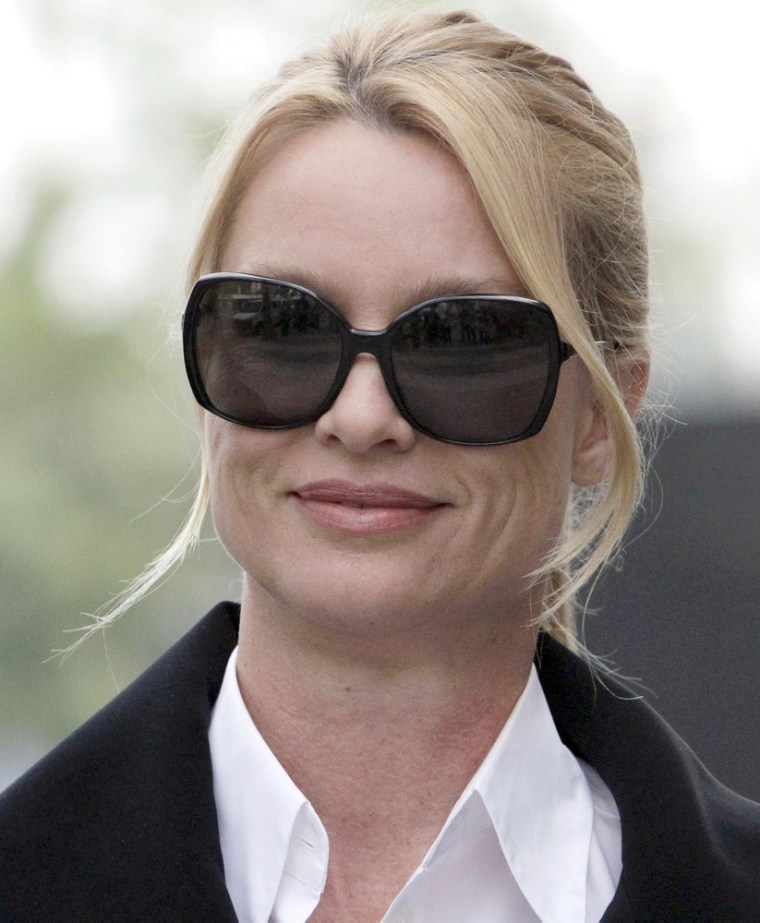 """Nicollette Sheridan arrives at court Thursday, March 15, 2012, in Los Angeles. A jury will enter their second day of deliberations into Sheridan's claims that she was wrongfully terminated from the show during its fifth series. Her attorneys contend her forced departure from the show was retaliation for her complaining that \""""Desperate Housewives\"""" creator Marc Cherry hit her during an on-set dispute, but the veteran TV writer's attorney contends it was simply business. (AP Photo/Nick Ut)"""