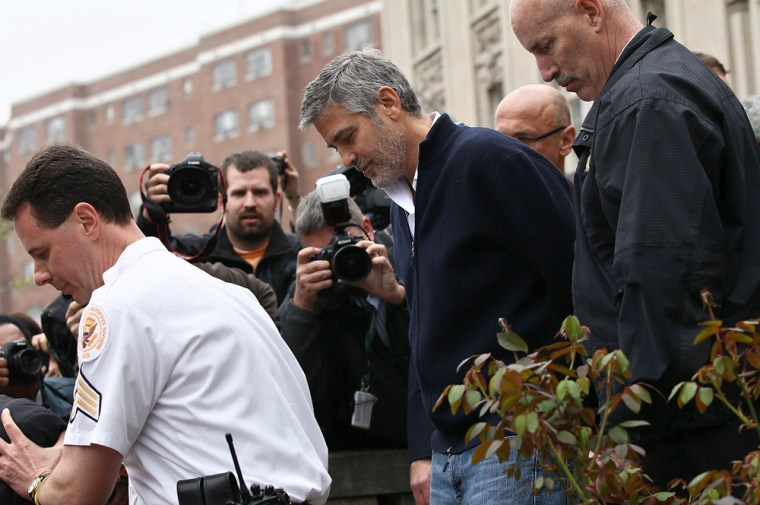 WASHINGTON, DC - MARCH 16:  Actor George Clooney (C) is arrested during a demonstration outside the Embassy of Sudan March 16, 2012 in Washington, DC. United to End Genocide, the Enough Campaign and Amnesty International held a rally to call on the United States and world leaders to stop the violence in South Sudan and prevent hundreds of thousands of people from starving.  (Photo by Win McNamee/Getty Images)