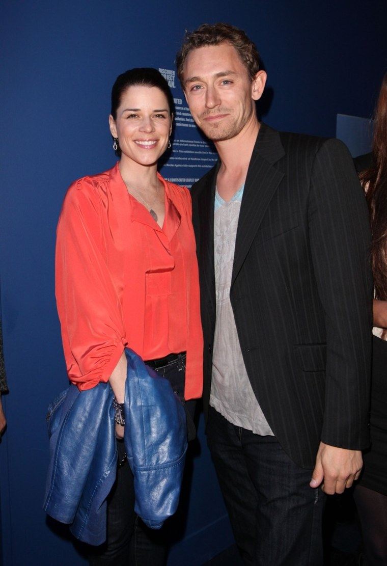 LONDON, ENGLAND - FILE: Neve Campbell and JJ Field attend the launch of Project Ocean at Selfridges on May 11, 2011 in London, England.  Feild and Campbell are expexting their first child together according to reports on March 16, 2012.  (Photo by Gareth Davies/Getty Images)