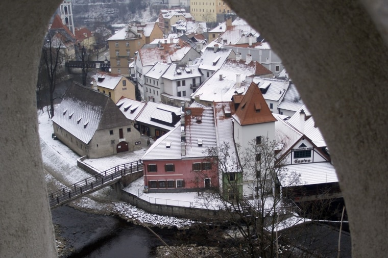 This November 2010 photo shows a view of Cesky Krumlov along the Vltava River as seen through a window in the Cesky Krumlov Castle, Czech Republic. Centuries of history have earned this Czech town a designation as a UNESCO World Heritage site. It's a Bohemian beauty, tucked into a horseshoe bend on the Vltava River, with interesting architecture, an enormous castle and a nearby national park.    (AP Photo/Shirley O'Bryan Smith)
