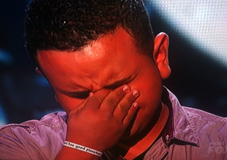 "Contestant Jeremy Rosado wearing the white bracelet given to him by \""Idol Pastor\"" Leesa Bellesi."