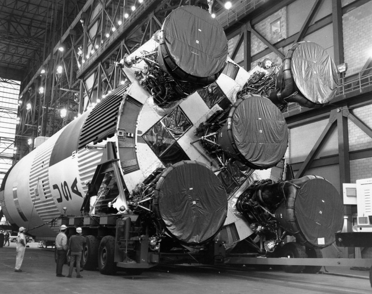 The five giant F-1 engines on Apollo 11's Saturn 5 rocket loom large during preparations for the 1969 launch from NASA's Kennedy Space Center. Amazon.com billionaire Jeff Bezos says his team has located the engines, which fell into the sea just minutes after liftoff.