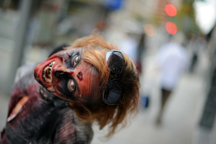 """An actress helps promote the TV series \""""The Walking Dead\"""" outside a Washington, D.C., subway entrance in 2010."""