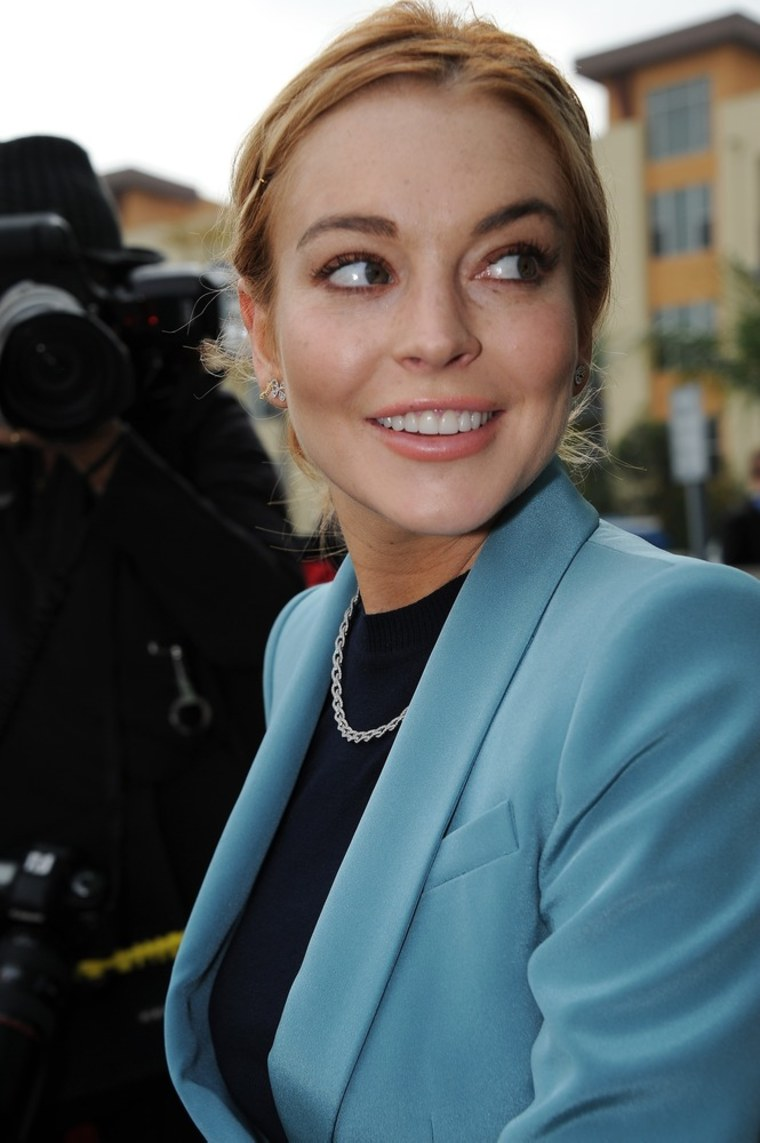 Lindsay Lohan is all smiles as she leaves Los Angeles Superior Court on Thursday.