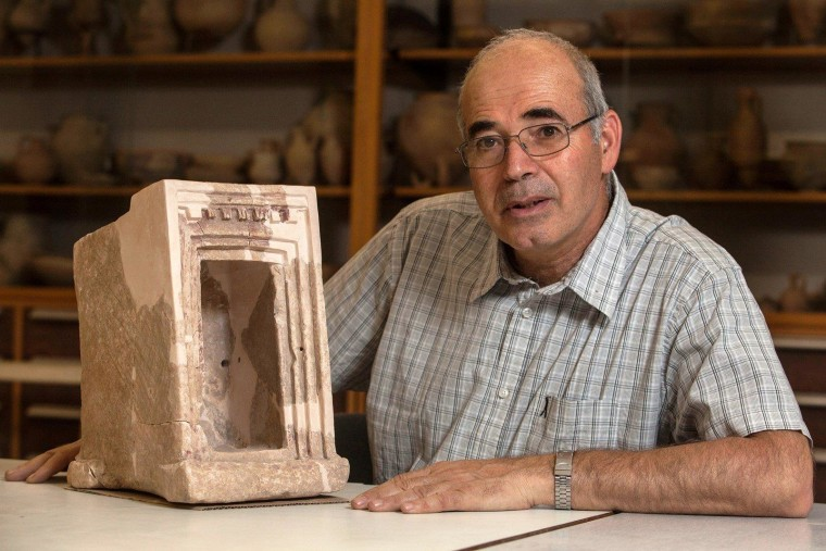 Yosef Garfinkel, an archaeologist at the Hebrew University of Jerusalem, shows off a stone shrine model that was found during excavations at Khirbet Qeiyafa, an ancient settlement southwest of Jerusalem.