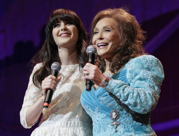 "Country music star Loretta Lynn, right, and actress Zooey Deschanel sing Lynn's hit ""Coal Miner's Daughter"" in Nashville, Tenn., on Thursday."