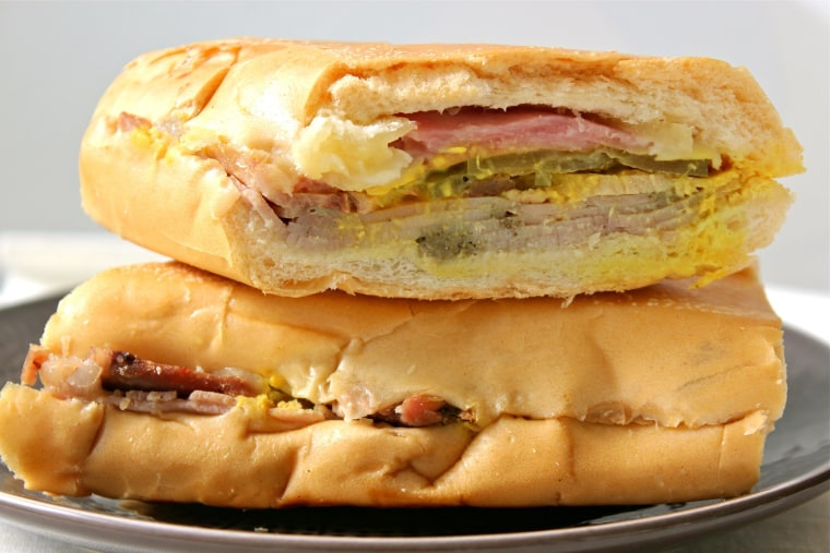 A Cuban sandwich is made with slices of mojo-flavored roasted pork butt, mild, smoked ham, Gouda or Swiss cheese, pickles and mustard. After that, the disagreements begin.