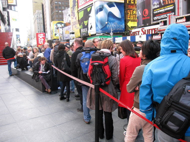 A line of ticket-buyers wait at the TKTS booth, which sells discount tickets to Broadway shows,  in New York's Times Square on Wednesday, Oct. 31.