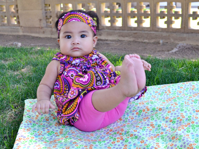 Gerber baby contest winner Mary Jane Montoya strikes a pose for her mom and dad.