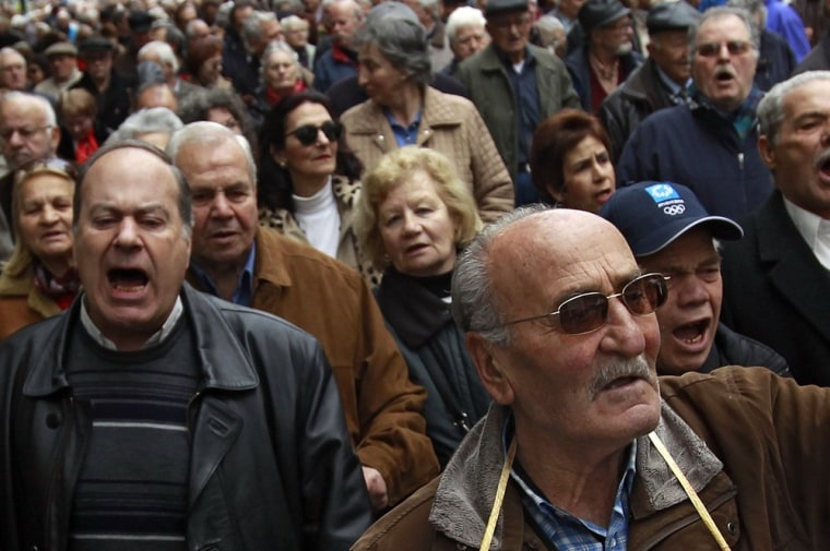 Pensioners demonstrate during an anti-austerity rally in Athens on Tuesday. Greece has admitted it still faces a tough job in persuading the European Union and IMF to save it from bankruptcy.