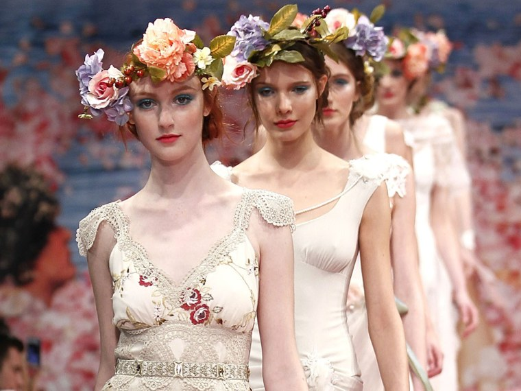 What will the most daring brides wear next season? Perhaps some dramatic pleats, a headband, or maybe even the color pink!