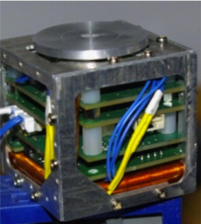 A fully assembled CubeSat satellite, complete with sensors and computer chips. The CubeSat's body was created using a 3-D printer.