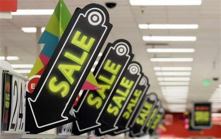 Sale signs are displayed Nov. 23 at a Target store in Colma, Calif.