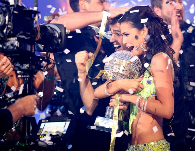 """Melissa Rycroft and pro partner Tony Dovolani hold the mirror ball trophy as they are crowned champions on the season finale of ABC's \""""Dancing with the Stars: All-Stars\"""" in Los Angeles on Tuesday."""