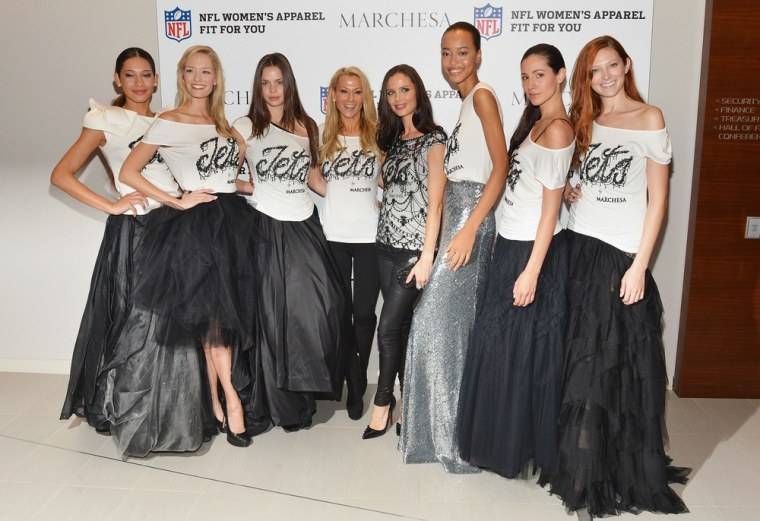 Suzanne Johnson, wife of Jets owner Woody Johnson, and designer Georgina Chapman pose with models in their styligh NFL gear.