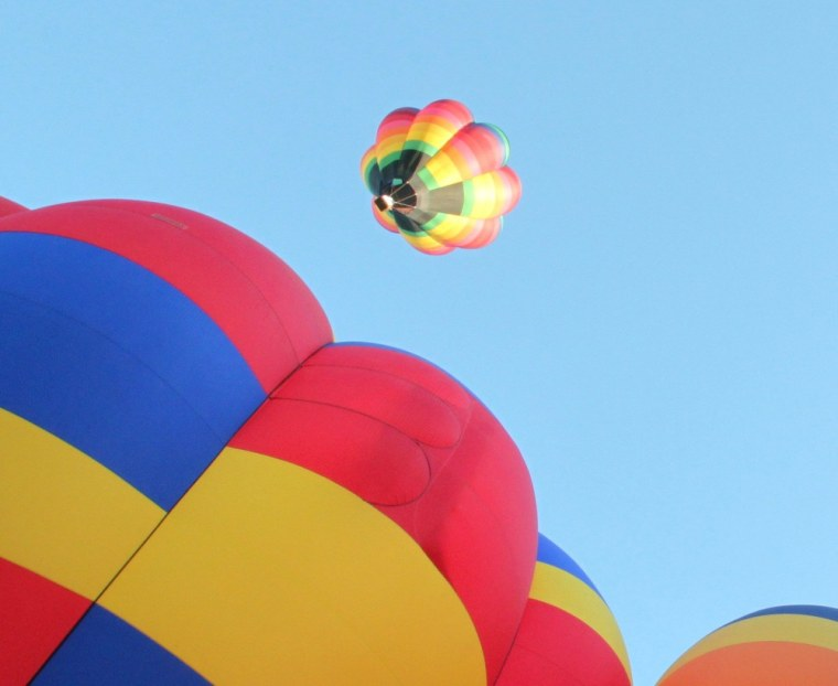 Hot air balloons ascend during the annual  Albuquerque International Balloon Fiesta in Albuquerque, N.M., in 2010.