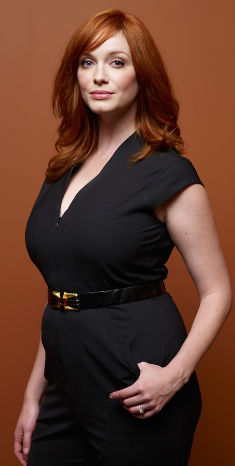 """Actress Christina Hendricks, shown here at the 64th annual Prime Time Emmy Awards, has been praised for her curvaceous body, but doesn't appreciate being called """"full-figured."""""""