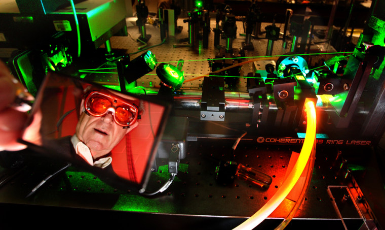 University of Washington physicist John Cramer, seen here in a 2007 photo, has been working on a laser experiment to test whether causality can work backward in time.