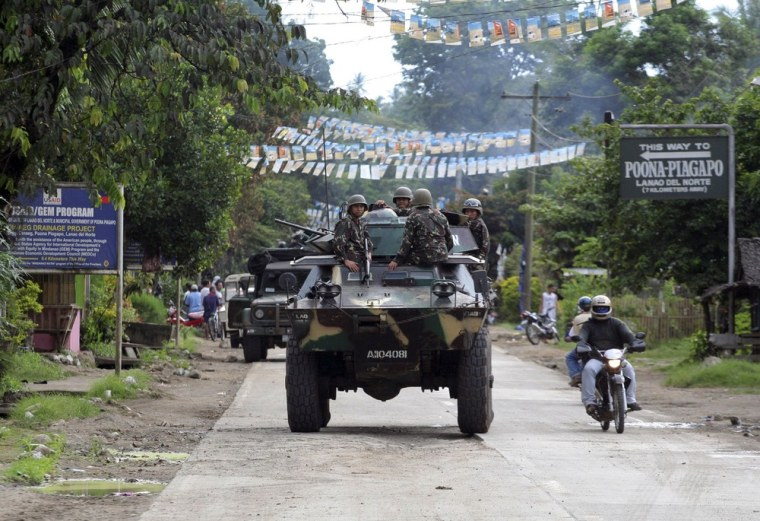 Philippine soldiers patrol the town of Kauswagan in Lanao del Norte, southern Philippines, in August, 2008. The Philippine government and Muslim rebels have agreed a peace deal to end a 40-year conflict that has killed more than 120,000 people, President Benigno Aquino said on Sunday.