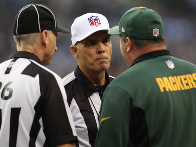 Lance Easley (left) during the controversial Seahawks-Packers game of Sept. 24, with referee Wayne Elliott (center) and Mike McCarthy, head coach of the Packers.