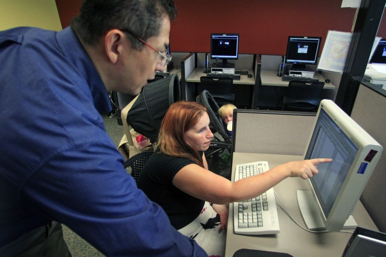 A job seeker in Salt Lake City, right, receives assistance from an employment counselor.