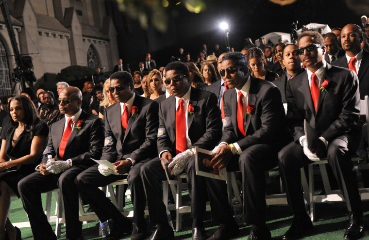 The Jackson family (Janet Jackson at far left) attend Michael Jackson's funeral service in 2009.